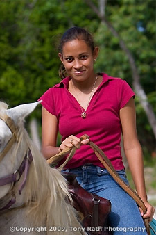 Creole girl on horse